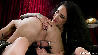 Big Bust dominatrix rides strapped male slave